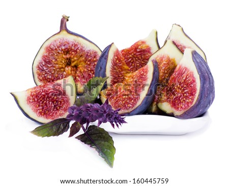 Some slices of fig and basil flower - stock photo