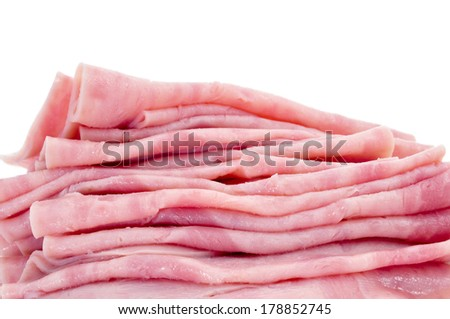 some slices of ham on a white background - stock photo