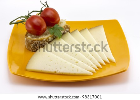 some slices of manchego cheese from Spain, Bread and tomato - stock photo
