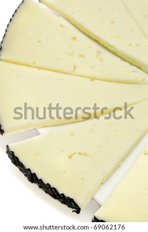 some slices of manchego cheese isolated on a white background - stock photo