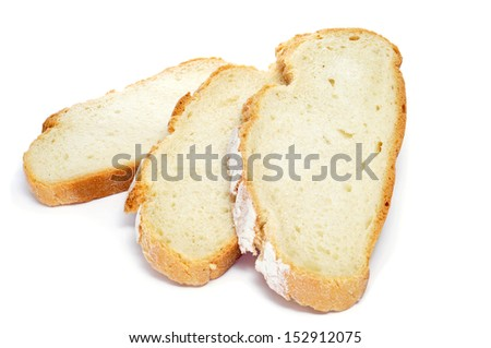 some slices of pan de payes, a round bread typical of Catalonia, Spain, on a white background - stock photo