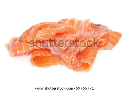 some slices of smoked salmon on white background - stock photo