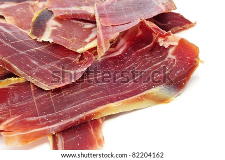some slices of spanish serrano ham on a white background