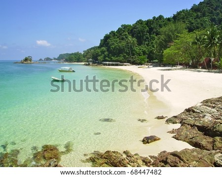 some small boats on a tropical beach in Malaysia - stock photo