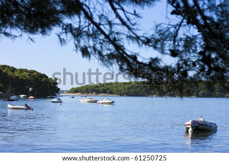 Some small motorboats in beautiful bay in croatia - stock photo