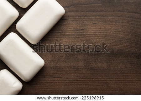 some soap bars on the wooden table - stock photo