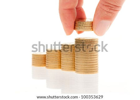 some stacks of coins on white background - stock photo