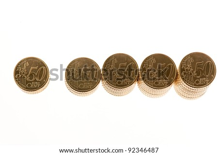 some stacks of coins on white background â?¬ - stock photo