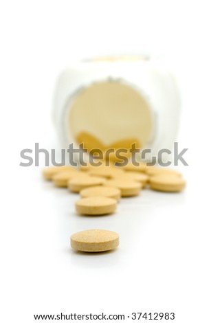 Some tablets are poured out from a jar