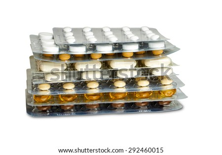 Some tablets blister packs with various pills and capsules stacked and isolated on white background - stock photo