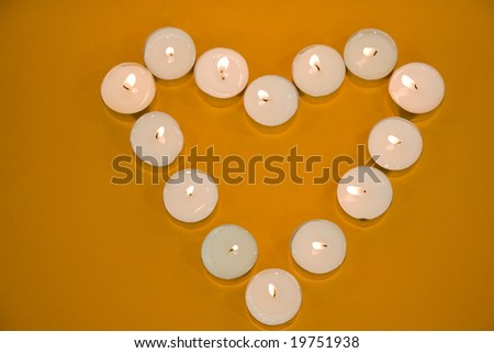 Some tea lights arranged as a heart