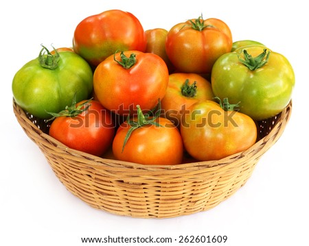 Some tomatoes in a basket over white background - stock photo