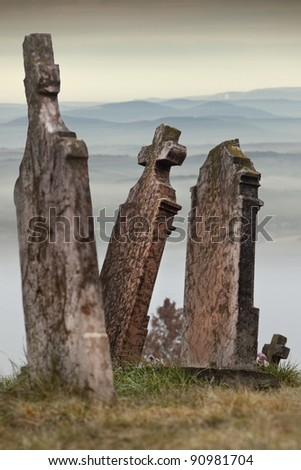 Some tombstones in an old cemetery, Hungary - stock photo