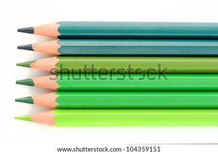 Some tones of green crayons isolated over white background - stock photo