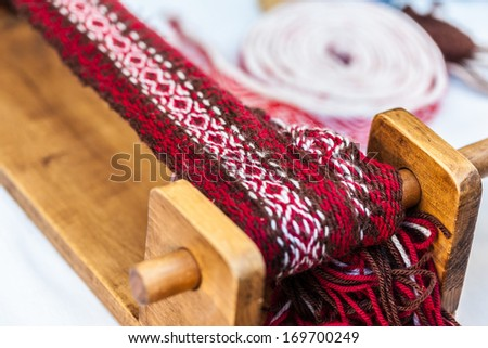 some traditional sewing and knitting tools in a medieval fair - stock photo