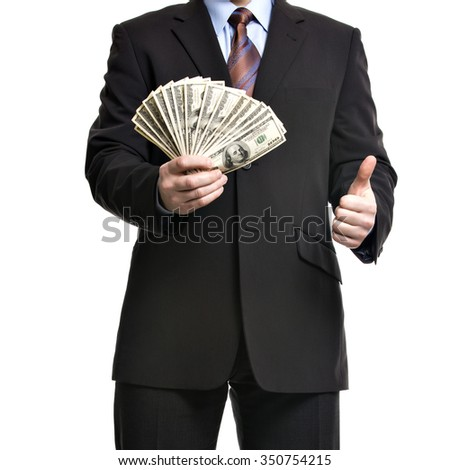 Some unrecognizable Businessman in suit showing  a Spread of Cash and thumb up, Isolated on white background. Man with dollars symbolizing Success, Motivation, Wealth. - stock photo