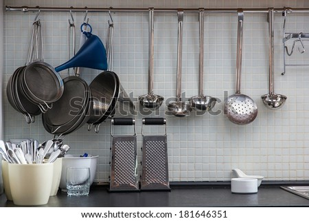 Some utensil on the kitchen wall - stock photo