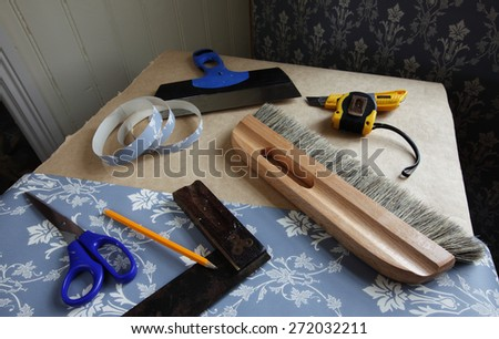 Some wallpapering accessories on working table.  - stock photo