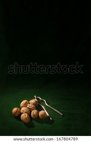 Some walnuts with an old nutcracker