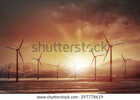 Some windmills standing in desert. Power and energy concept - stock photo