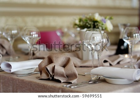 Some wine glasses on a festive table - stock photo