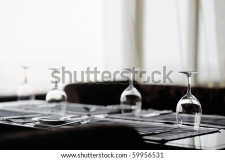 Some wine glasses on a table - stock photo
