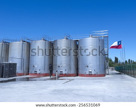 Some wine metallic fermentation tanks. Wine industry in Chile. The Chilean wine industry is the 7th world producer and the biggest exporter of South America. - stock photo