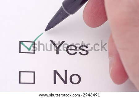 Someone indicating yes on a survey in green pen - stock photo