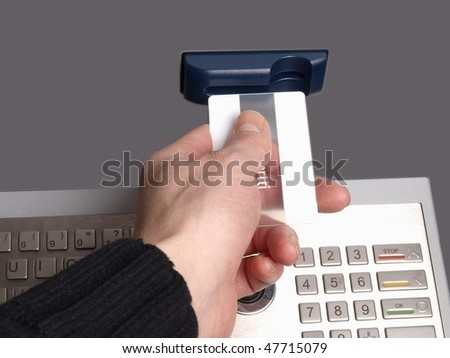 Someone inserting a card into a ATM machine, on white background - stock photo