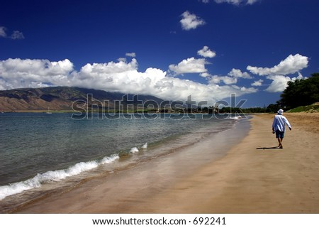 Someone walking on the beach in Kihei, Maui Island, Hawaii. - stock photo