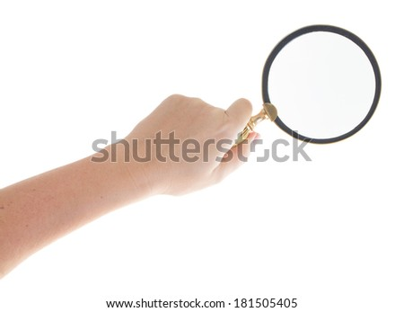Someones hand holding a magnifying glass isolated on white background - stock photo