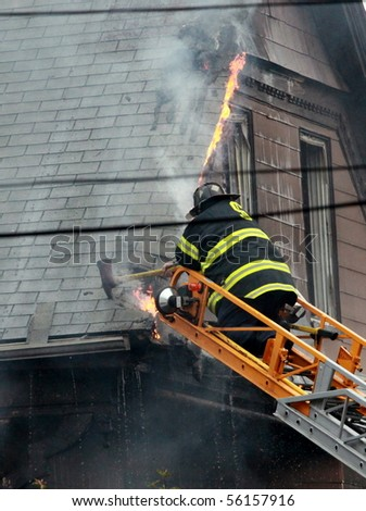 SOMERVILLE, MASSACHUSETTS - JUNE 27: Firefighters from at least four fire houses battle a blaze at 111 Glenwood Road June 17,2010 in Somerville, MA
