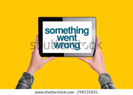 Something Went Wrong Message on Digital Tablet Computer Display, Woman Holding Device, Isolated on Yellow Background - stock photo