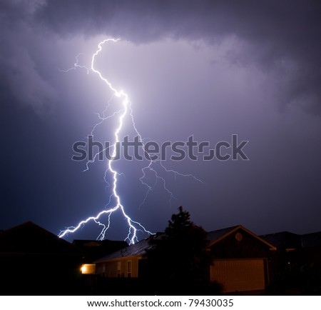 Sometimes there are not any words. This epic thunderstorm produced one of the best light shows I have ever seen. Lightning was striking anything that was standing in near our home. - stock photo