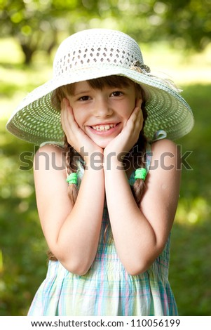 Somewhat surprised cheerful girl in the hat