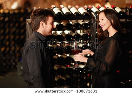 Sommelier offers wine tasting - stock photo