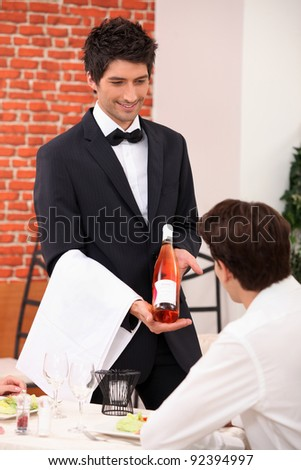 Sommelier presenting a wine - stock photo