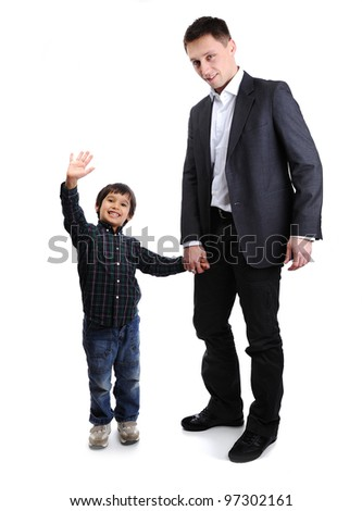 Son and father, child and adult standing, full body - stock photo