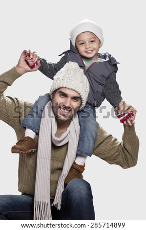 Son and father in playful mood white background - stock photo