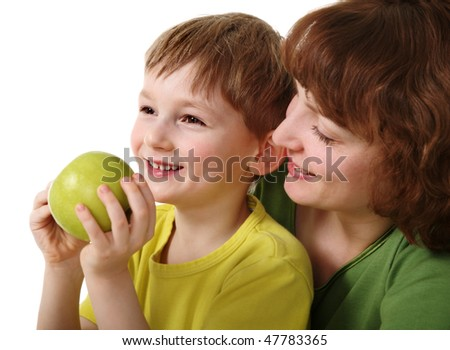 Son and mother with apple - stock photo