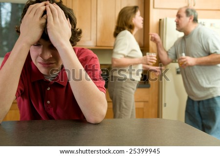 Son cries as parents fight - stock photo