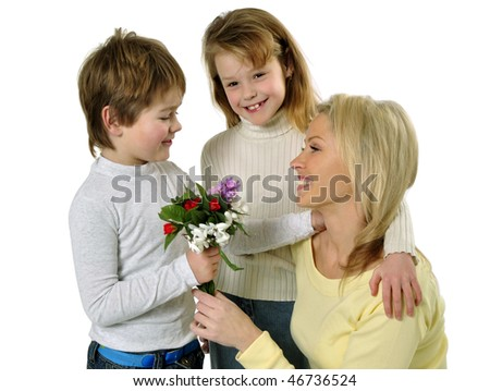 Son giving flowers to her mom on mother's day - stock photo