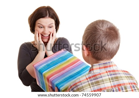 Son giving his surprised mother a big present - stock photo