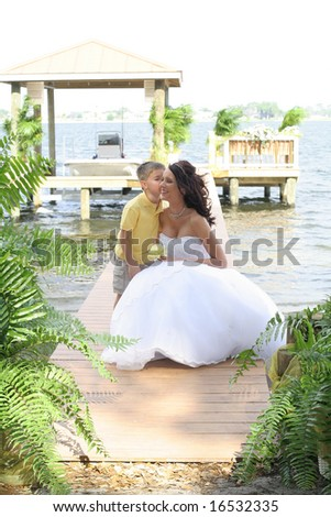 son giving mother a kiss - stock photo