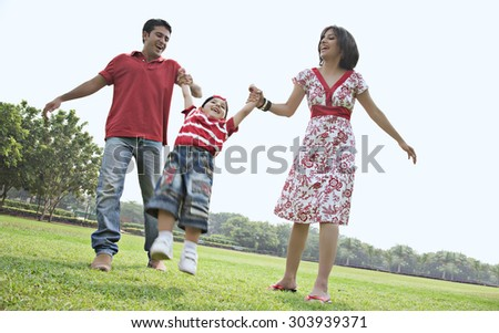 Son having fun with his parents - stock photo