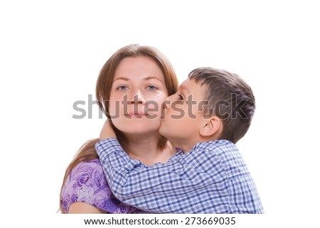 Son mom hugs and kisses her on the cheek