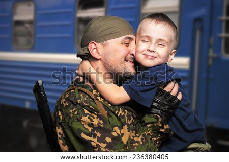 son's meeting with the father who came back from war - stock photo