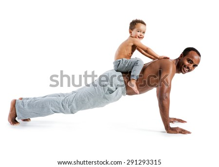 Son sitting on his father's back / photo set of sporty muscular Hispanic shirtless fitness man with his son over white background - stock photo