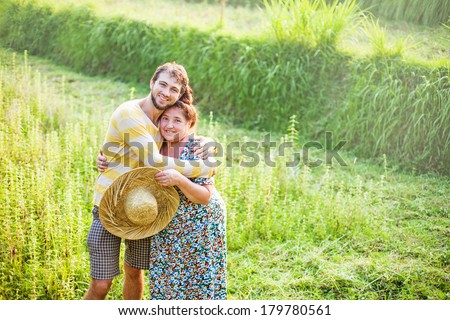 son with his mother at the field - stock photo