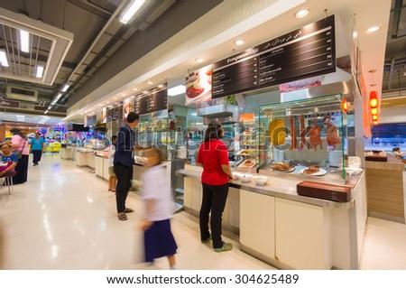 Songkhla, 26 june 2015: Interior of food court in Tesco Lotus Extra hypermarket in Songkhla, Songkhla province, Thailand. - stock photo